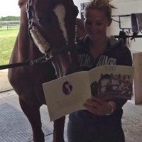 Olivia Oakeley and her dressage horse Donna Summer, taking a well earned break, following coming 5th in the European Young Riders Championships in Arezzo Italy. Ted gave her horse a copy of his book.